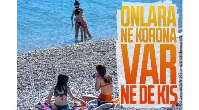 Sıcak hava koronavirüsü unutturdu! Antalya'da sahiller doldu